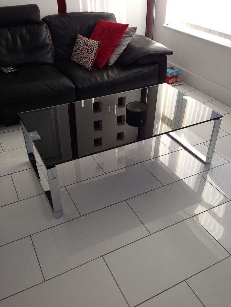 Black And Chrome Glass Topped Coffee Table
