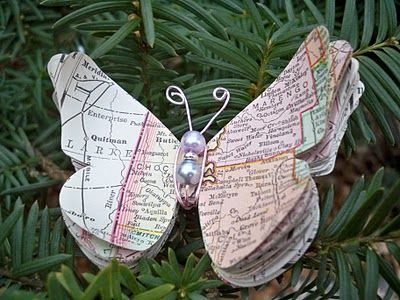 Cut the butterfly shape out of a map from where you went on a family vacation. Keep adding to it over the years. Hang it on your christmas tree as a vacation memory reminder :)