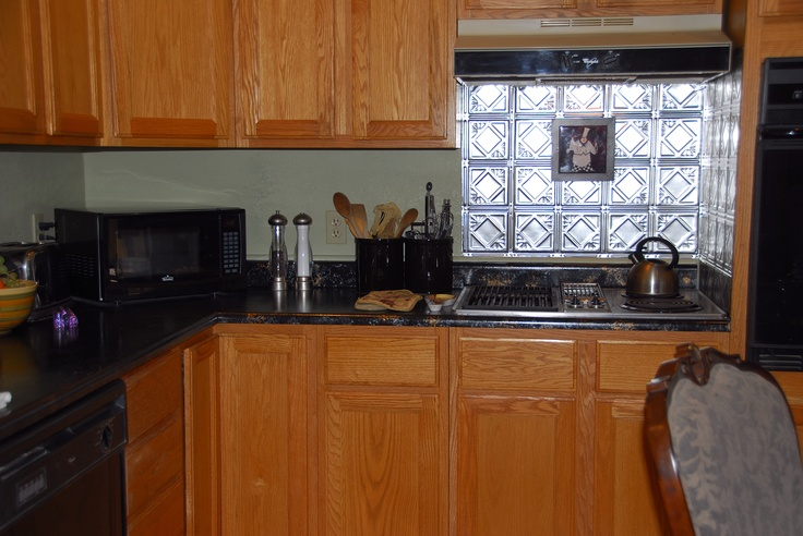 pressed tin backsplash behind and next to stove complete love it not