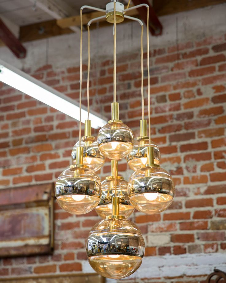 Incredibly rare Peill and Putzler 7 Orb Chandelier from 1960s Germany $4,431.25 Dimensions: 18.5″W (approximate)