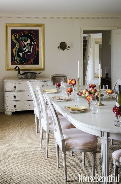 In the dining room, a sea-grass rug covers the floor. Ireland reupholstered the owners' Gustavian chairs and had the matching table made by the Lief gallery. Click through for more pictures of Jackie Kennedy's beach house.