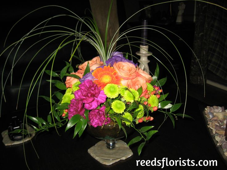Bring home your wedding table centres to brighten up your own home and remind you of your special day. Flowers by www.reedsflorists.com