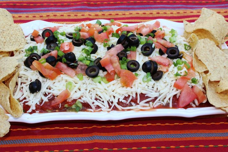 This is a new twist on a layered taco dip. The jalapeno bean dip on the bottom is a good choice, but what makes this really different is the sour cream layer.