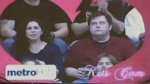 Best kiss cam ever... I love the woman's fascial expressions