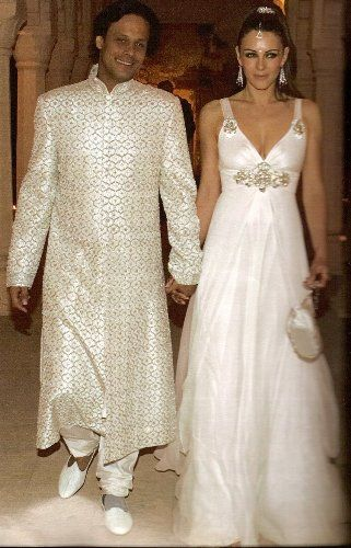 English actress Elizabeth Hurley wore a Jenny Packham bridal gown for her March 2007 wedding to Indian textile heir Arun Nayar, who has run a software company since 1998. They divorced in 2011.