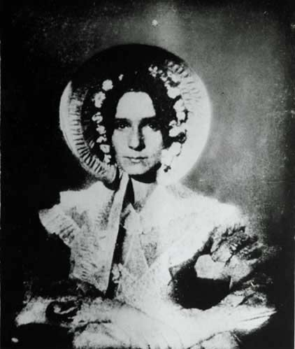 First successful photograph of a woman, 1839.