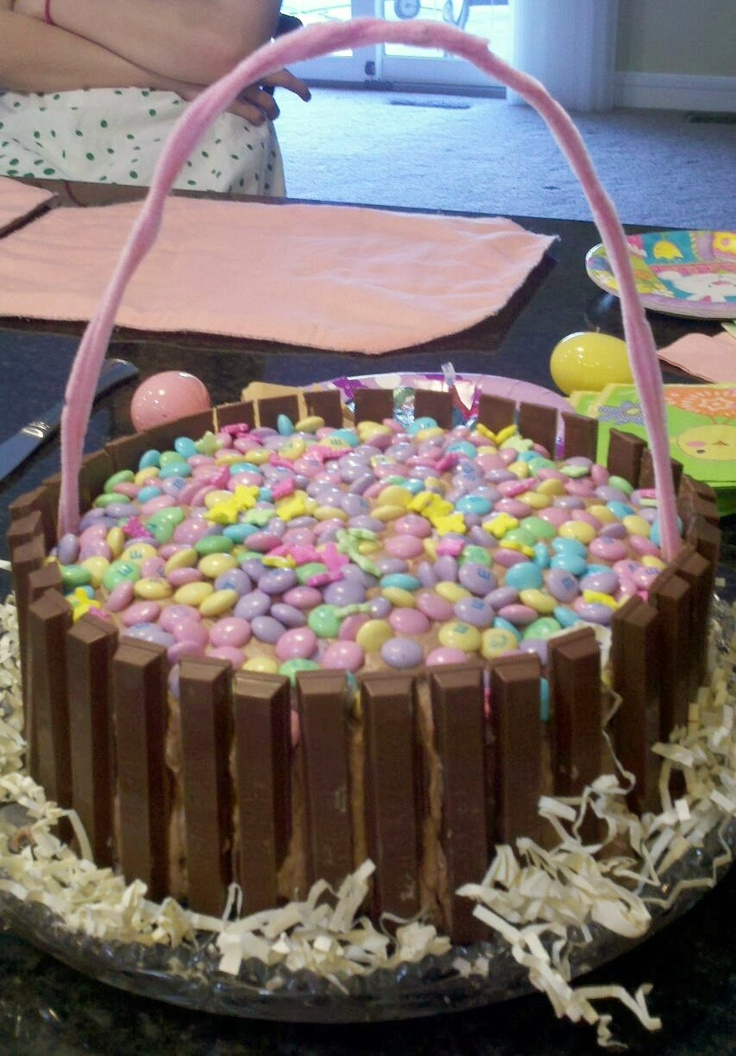 Easter Basket Cake I made for Easter 2012. 2-layer Chocolate cake with homemade chocolate buttercream frosting, kit kats, Easter M, and twisted pink pipe cleaners for the handle.