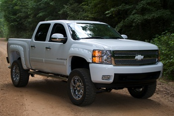 "Custom Chevy Silverado with 6"" Lift, 20'' wheels and custom Grill Plate. #cooltruck"