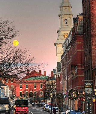 """Portsmouth, NH - their annual Christmas """"Candlelight Stroll"""" in historic Strawbery Banke was a memorable highlight of my freshman year at UNH. I especially loved the various music - from chamber quartet to brass band to bell choir - scattered among the historic homes, luminaria-lit streets, and quaint shops."""