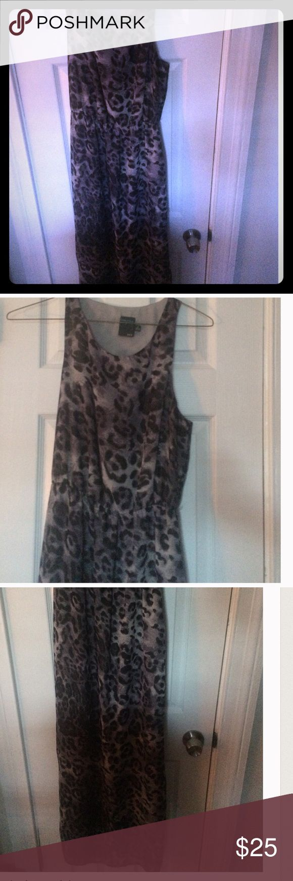 "Anthropologie Gabby Skye Leopard Maxi Dress 👗 Like new nylon loose fit with elastic waist dress. It features 2 slits on the sides that go up to just above your knees. I am 5'7"" and it the length goes to my ankles. Size 8. Anthropologie Dresses Maxi"