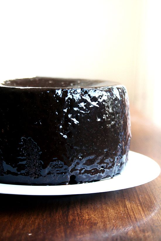 This cake is everything a chocolate cake should be: fudgy, moist, intensely chocolaty. When assembled into layers with chocolate ganache slathered in between, it becomes the perfect birthday finale for any chocolate lover. As a half recipe topped with black velvet icing, it can be an elegant dessert, a perfect treat to whip up if you find yourself hurricane housebound or to snack on with your morning coffee! // @alexandracooks