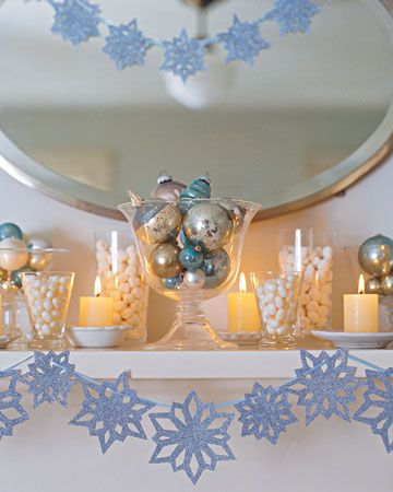 This cool blue snowflake themed holiday display is a chic alternative to traditional red and green decor.