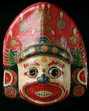 An old festival mask depicting the god Dhumma