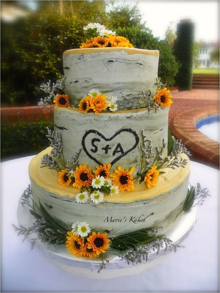 Creative_birch wedding cake adorned with sunflowers
