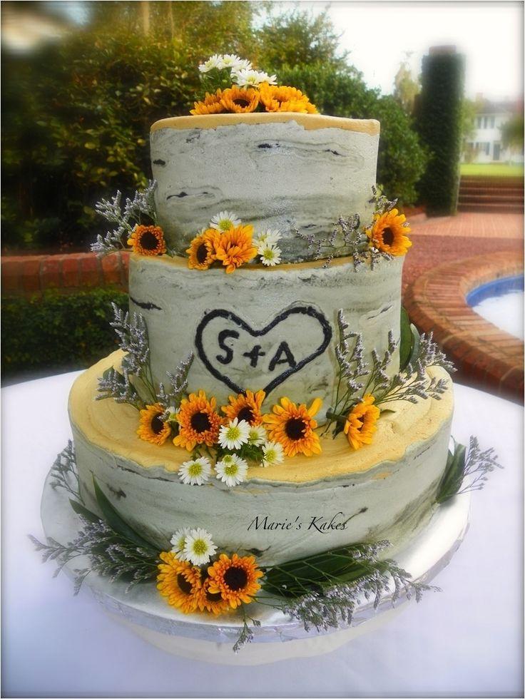 Creative_birch wedding cake adorned with sunflowers