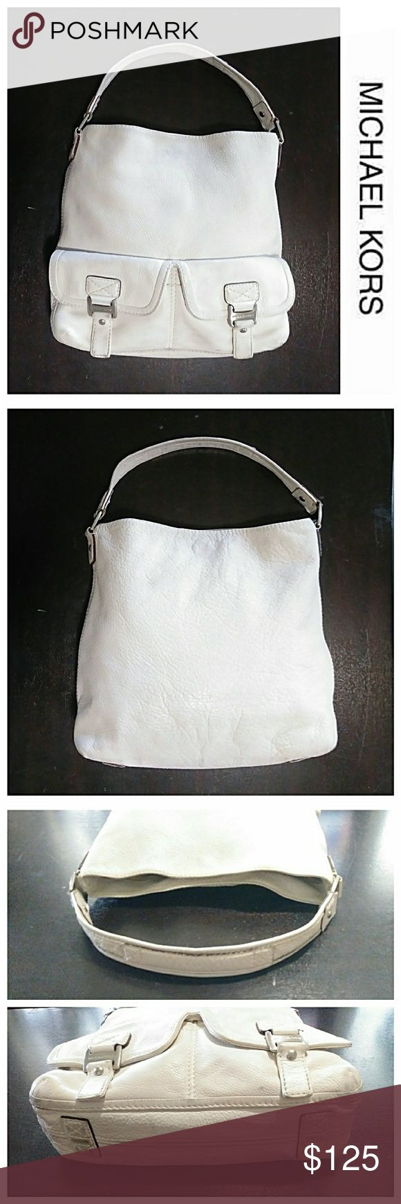 "MK Pebbled Leather Slouch Hobo Bag Authentic MK bag made of thick pebbled leather. The body is white and the hardware is silver. As you can see there are some obvious blemishes, but it's great shape overall. Measures 12"" H x 14"" L + 6"" strap drop. 💥 Reasonable Offers Accepted 💥 Michael Kors Bags Hobos"