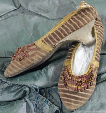 From Thierry De Maigret auctions, Paris:   Pair of yellow and violet shoes from the late 1700s. Ruched trim.  Sold for 1400 Euros during summer, 2010. Original auction estimate was 200-250 euros.