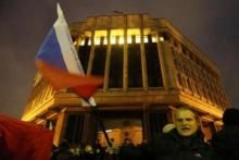 Gunmen Seize Local Parliament in Crimea Ukraine put its police on high alert after dozens of armed pro-Russia men stormed and seized local government buildings in Ukraine's Crimea region early on Thursday, and raised a Russian flag above the building.