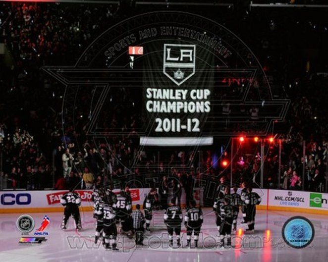 The Los Angeles Kings watch as their 2011-12 Championship Banner is raised
