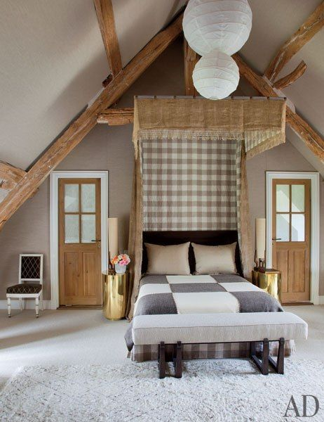 Jean-Louis Deniot ~ The canopy in the master bedroom is of a Brunschwig & Fils fringed burlap; the canopy is lined with a cotton windowpane check and the walls are clad in a linen, both by Manuel Canovas from Cowtan & Tout, while the pillows are of a Loro Piana linen.