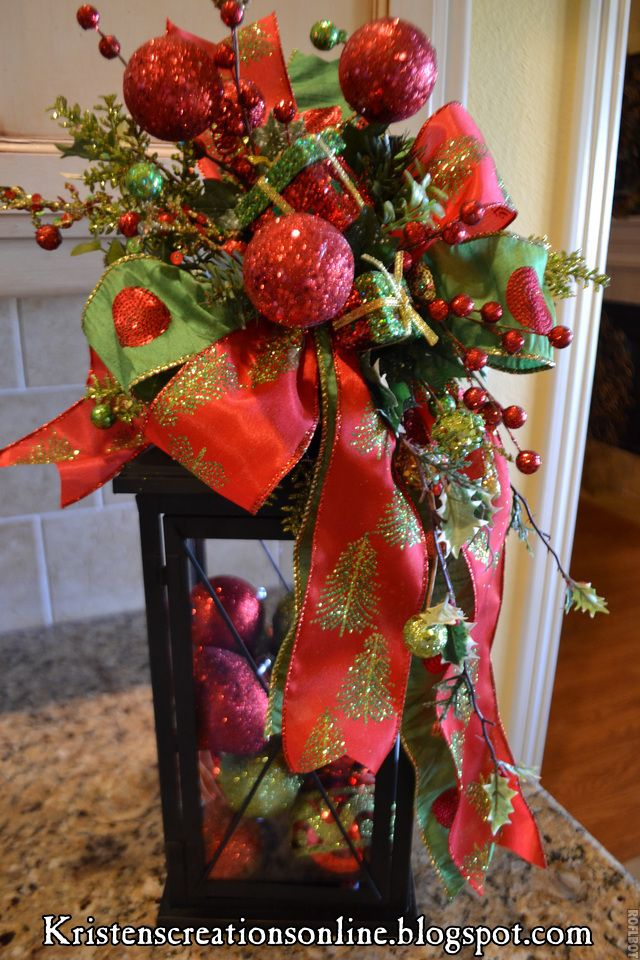 Christmas decor....add ribbon etc to tops of lanterns filled with ornaments (for front porch!)