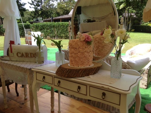 swiss meringue buttercream rosette cake  on log and mirror stand
