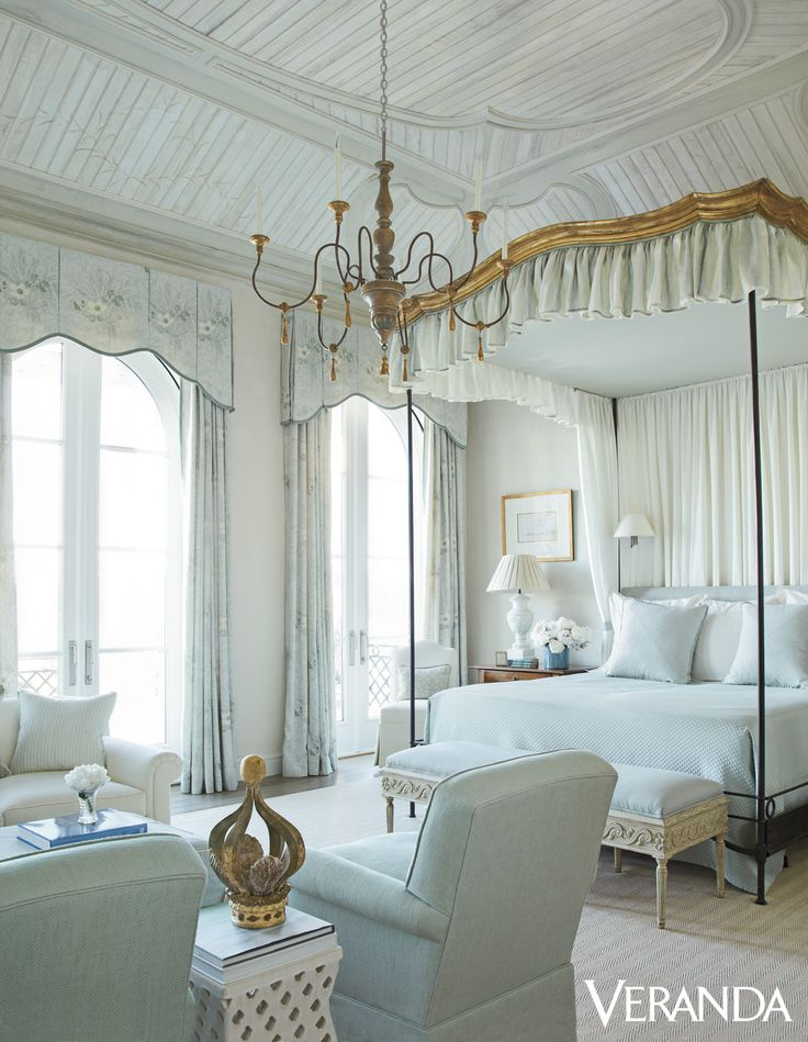 This Floridian home features a whitewashed ceiling and a romantic custom canopy bed , with pillows in Summer Hill fabric, Pindler & Pindler linens, and curtains in Hodsoll McKenzie sheer.   - Veranda.com