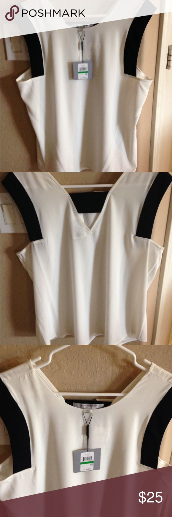 Marc New York Andrew Marc eggshell/black top-Large Marc New York Andrew Marc eggshell/black top - Size Large. This top has a great cut to it. It is 97% polyester and 2% spandex. Sure to accent any outfit. Mark New York Andrew marc Tops Blouses