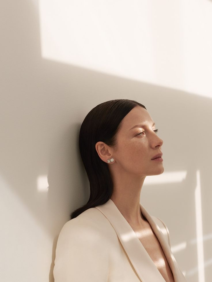 Captured in natural light, Caitriona Balfe modes a Bally blazer and Effy Jewelry earrings for InStyle Magazine April 2016 issue