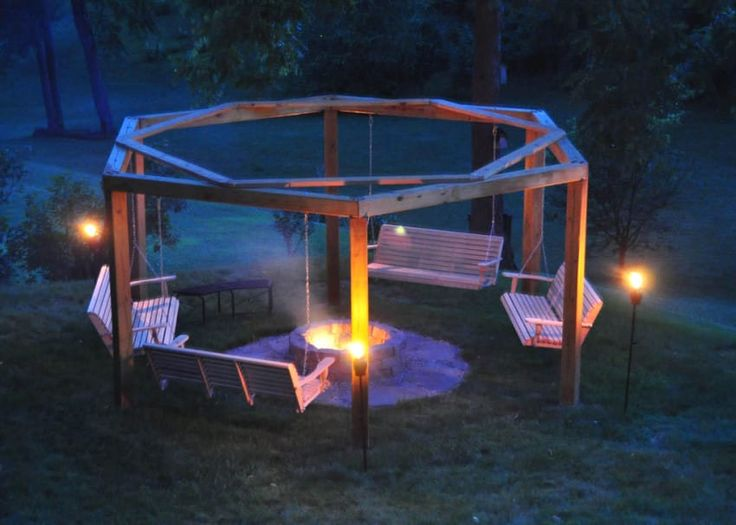 fire pit with porch swings around it.