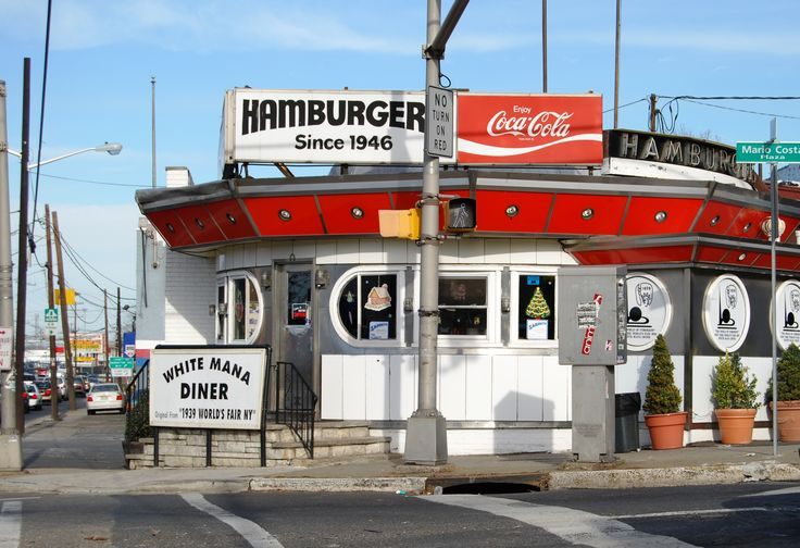 "The White Mana, located at 470 Tonnele Avenue in Western Slope in Jersey City is a historical landmark, as well as the first Manna to open and was the 1939 World's Fair building. When originally introduced, it was called the ""diner of the future"" and an ""Introduction to Fast Food."" According to the present owner, Mario Costa, Jr., the difference in spelling was the result of an error when the sign was serviced. It is famous for its hamburgers and sells approximately 3,000 a week."