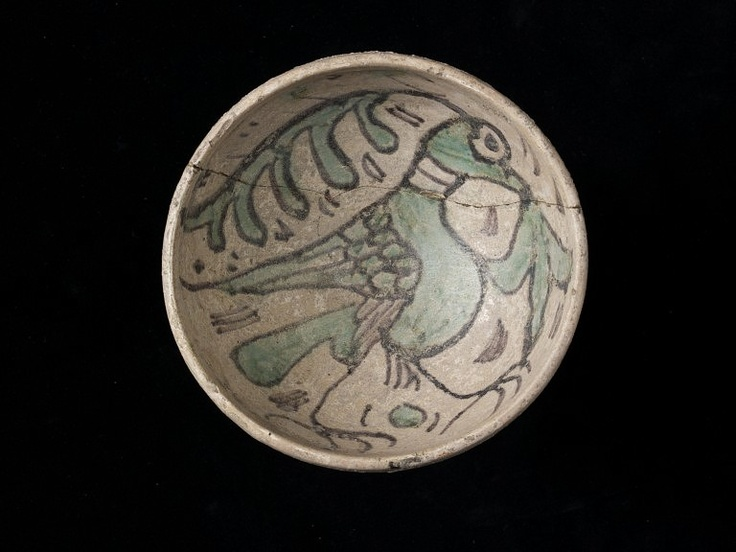 Earthenware covered with a thin tin-opacified lead glaze and painted in a blackish pigment and copper green, ca. 1375-1450.