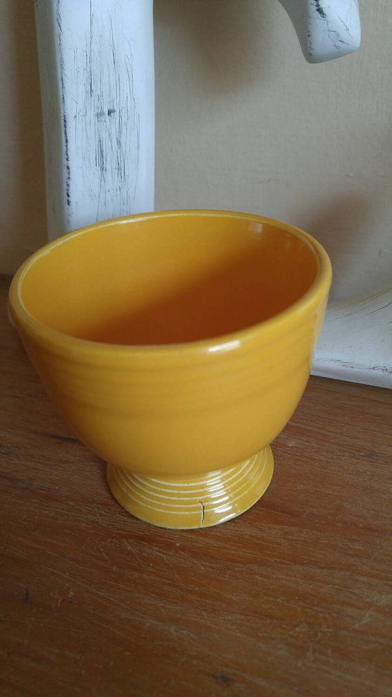 Check out this item in my Etsy shop https://www.etsy.com/ca/listing/466255563/fiestaware-egg-cup-in-marigold-yellow