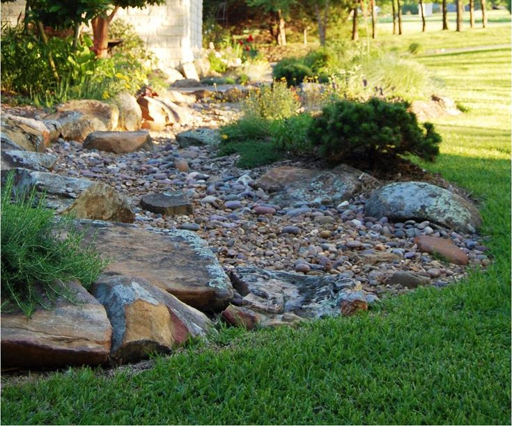 Dry creek bed landscaping border dry stream bed gallery for Landscape design plano
