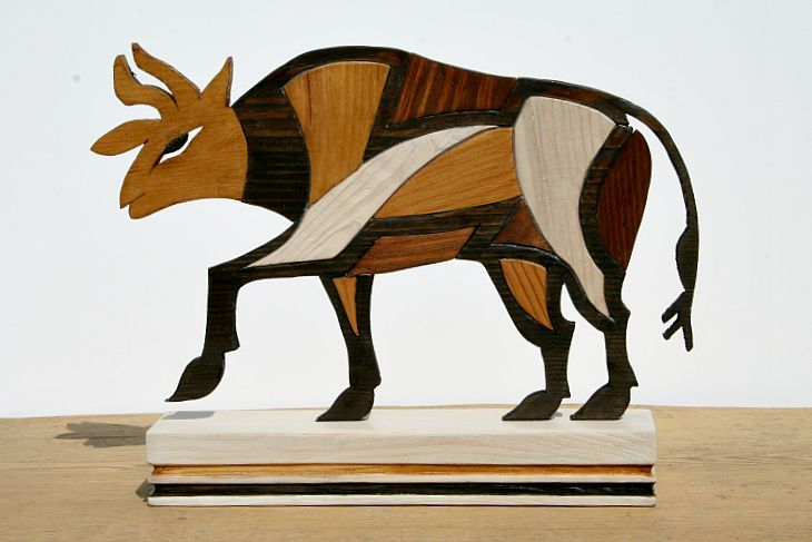 The wooden bull inspired by paintings on cypriot ancient pottery. hand made.