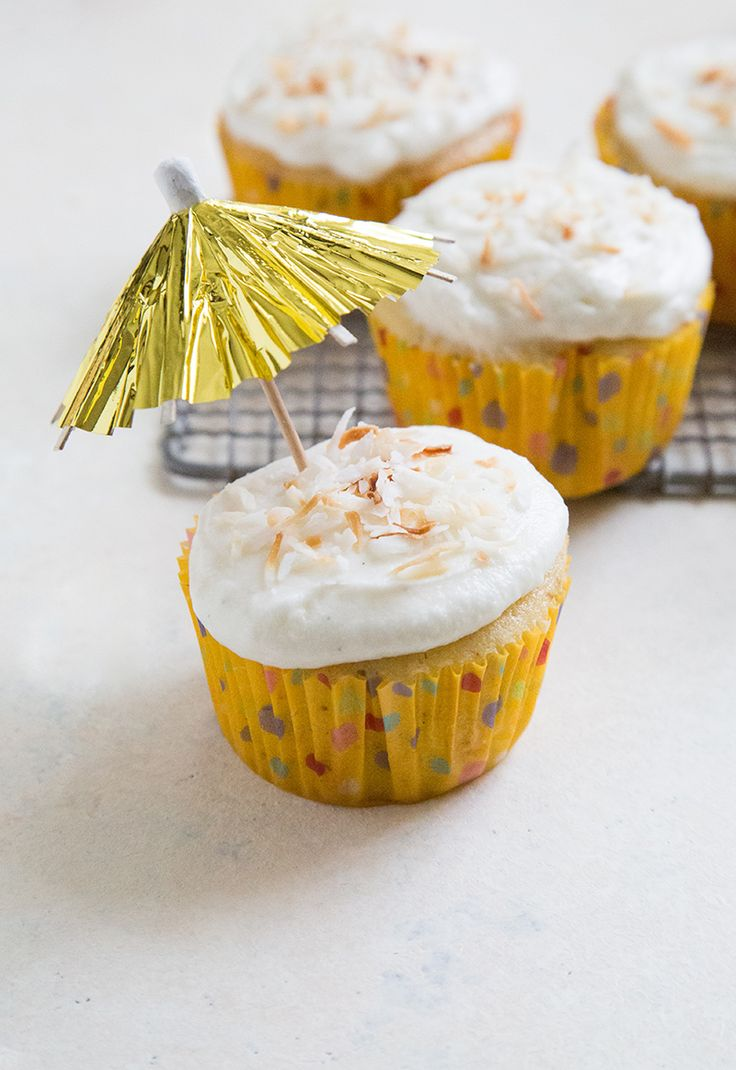 Until then, we're eating dozens of these pineapple coconut cupcakes in anticipation of summer vacation, beach trips, pool parties, and endless bottles of rosé!