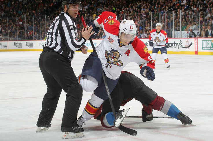 DENVER, CO - NOVEMBER 16: Marcel Goc #57 of the Florida Panthers skates for the puck just after facing off against the Colorado Avalanche at the Pepsi Center on November 16, 2013 in Denver, Colorado. (Photo by Michael Martin/NHLI via Getty Images)