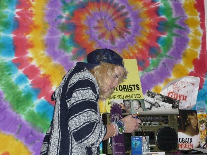 One of our talented friends, and she tie-dyed the backdrop herself!