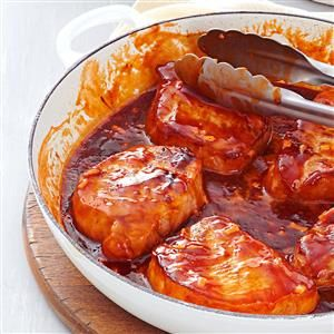 Sweet Barbecued Pork Chops Recipe -I often prepare a double recipe of these tangy chops, then freeze half to keep on hand. They're so easy and taste so fresh, family and friends never guess this quick entree was frozen! —Susan Holderman, Fostoria, Ohio