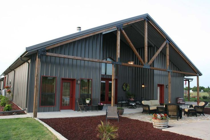 Rustic With Metal Buildings. Loving the exterior living space.