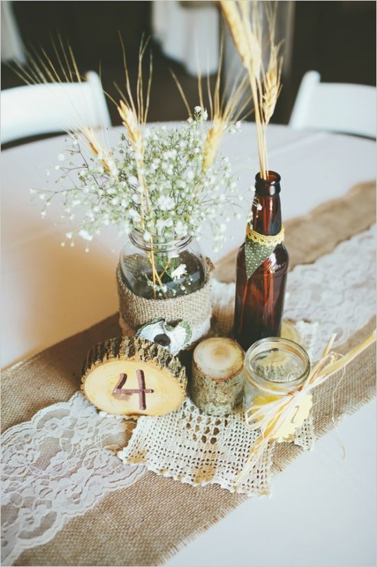 beer bottle and mason jar centerpieces #diy #rusticwedding #weddingchicks http://www.weddingchicks.com/2014/02/13/yellow-and-white-wedding/