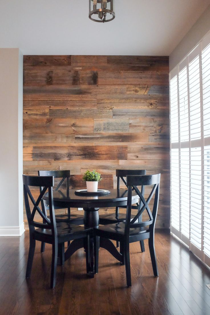 This beautiful brown barn board feature wall adds a modern rustic elegance to this dining space. Go to www.jeffmackdesigns.com for more info