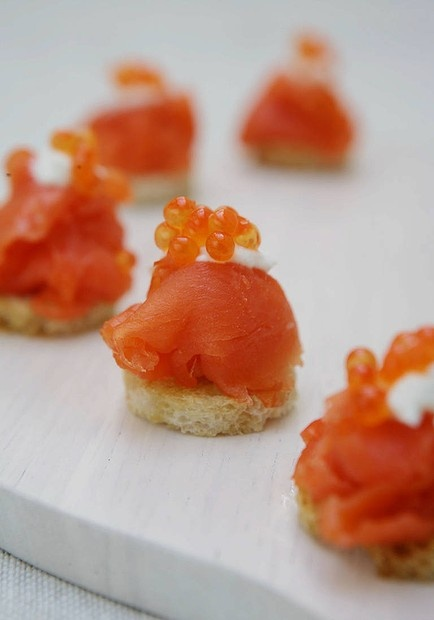 Party favourites ... Jane and Jeremy Strode's smoked salmon canapes. Photo by Marco Del Grande. Recipe: http://www.smh.com.au/lifestyle/cuisine/seafood/recipe/smoked-salmon-canapes-20111019-1m0ut.html?rand=1352070984054
