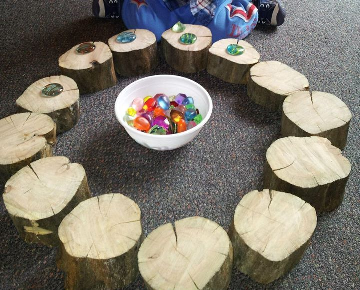 "Tree stumps & glass nuggets at Raylene's Family Day Care ("",) I saw this at a Bright Horizons center purchased at Menards which were fire starters. Just took out the flint in center $10. Nice if you do not have access to stumps!"