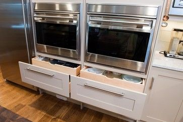 Love the drawers for baking dishes directly under two ovens, both at waist height for easy use. Would love to have the cookie sheets or thinner pans above the oven in upright slots.