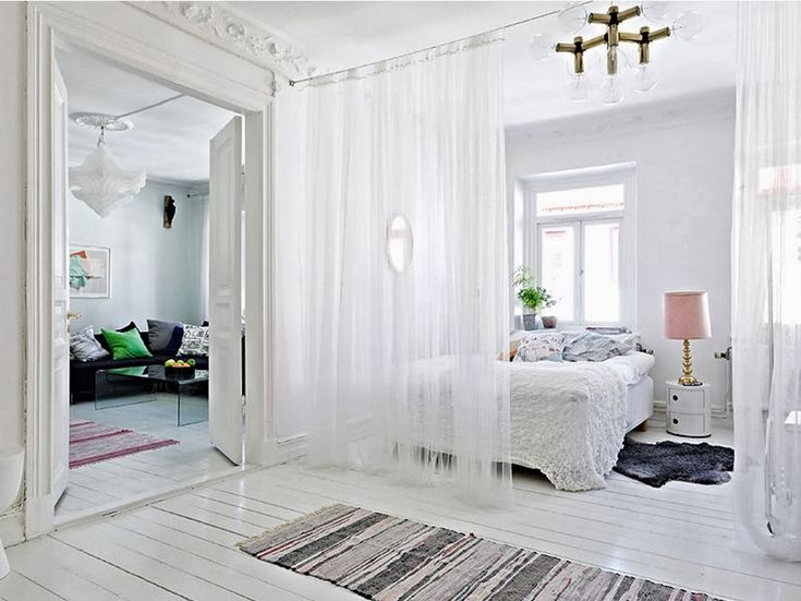 If you have no idea how to divide such a room here you have 18 clever room divider ideas that help you separate the rooms without walls.