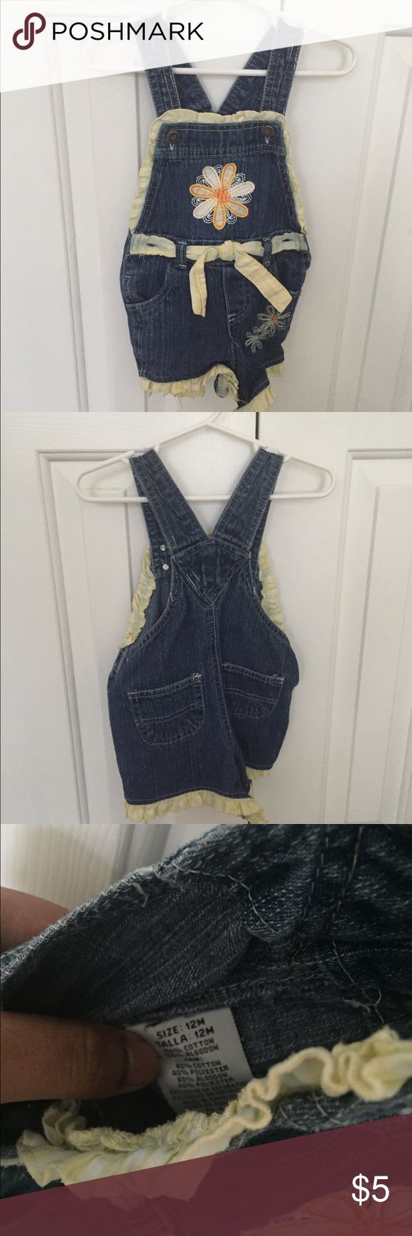Baby girl blue jean overall shorts. Size 12 months Blue jean overalls for baby girl with yellow accents. Fair condition. Bundle and save! Bottoms Jeans