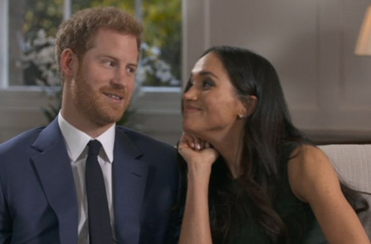 Meghan rests her chin on her fist while looking adoringly at her husband-to-be, who cannot help but smile back while being filmed for their first TV interview last night