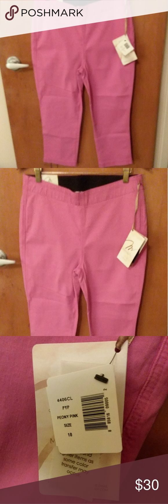 """Miraclebody by Miraclesuit Pink Leggings SZ 10 NWT This is a pair of Miraclebody by Miraclesuit cropped stretch leggings in size ladies 10 in Peony Pink. This item is New With Tags and originally retailed for $70. They are made of cotton, polyester and spandex in a substantial weight fabric. There is an elasticized waistband. Measurements are 31"""" waist, 38"""" hip, 21"""" inseam. There are no pockets. Miraclesuit Pants Leggings"""