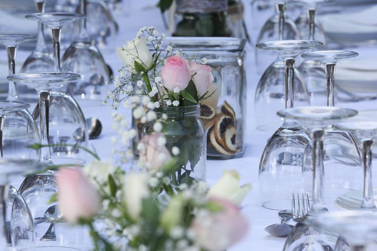 wedding decoration for farm wedding with vases and canles...